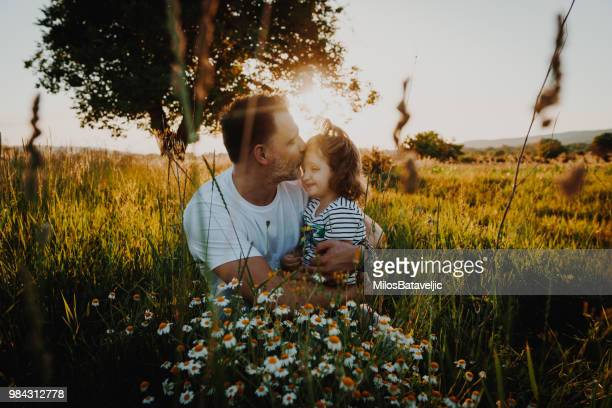 Father and daughter playing in wheat field