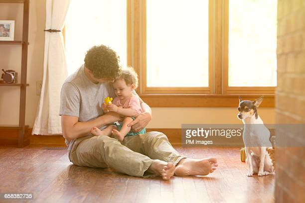 Father and daughter playing on floor