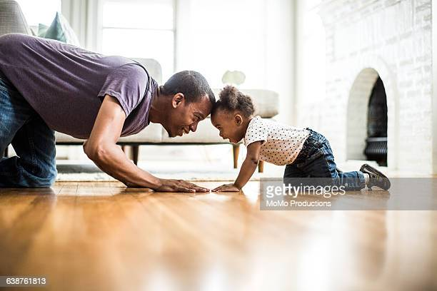Father and daughter playing on the floor