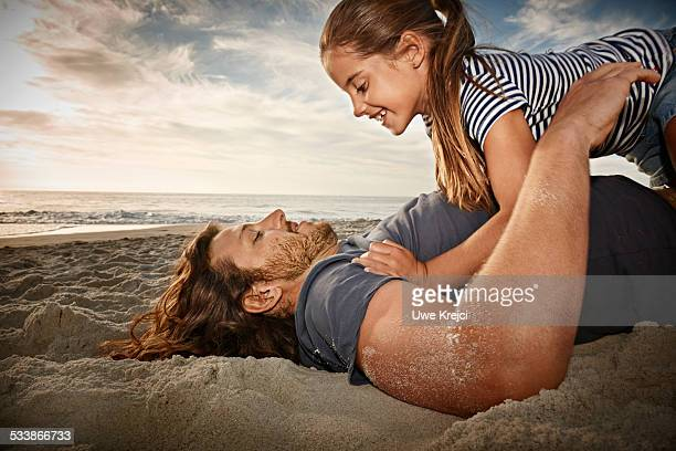 Father and daughter playing