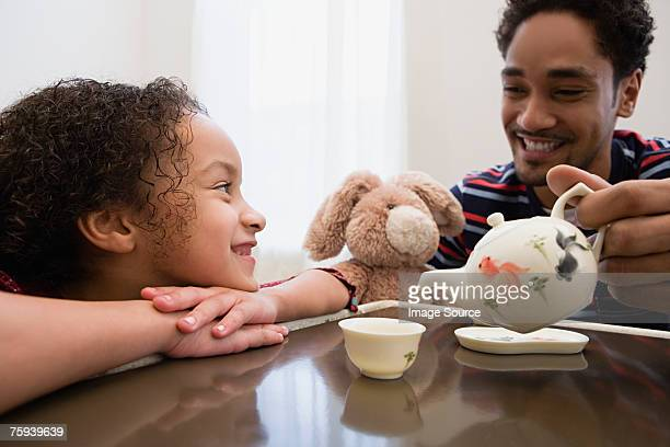 father and daughter playing - tea party stock pictures, royalty-free photos & images