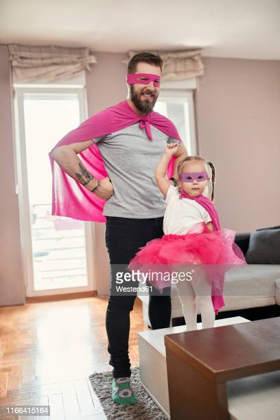 father and daughter playing superhero and superwoman - mask disguise stock pictures, royalty-free photos & images