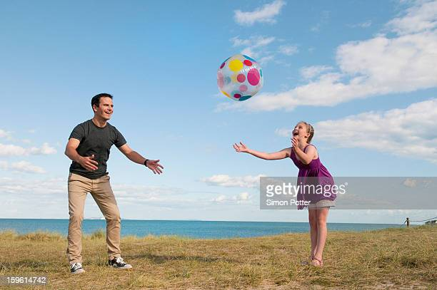 father and daughter playing together - catching stock pictures, royalty-free photos & images