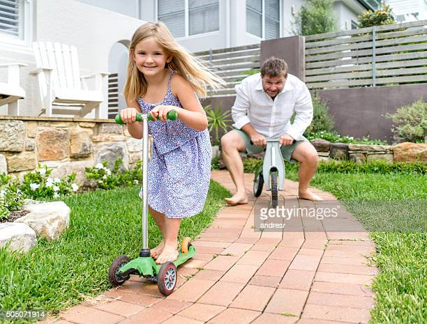 father and daughter playing together - tricycle stock pictures, royalty-free photos & images