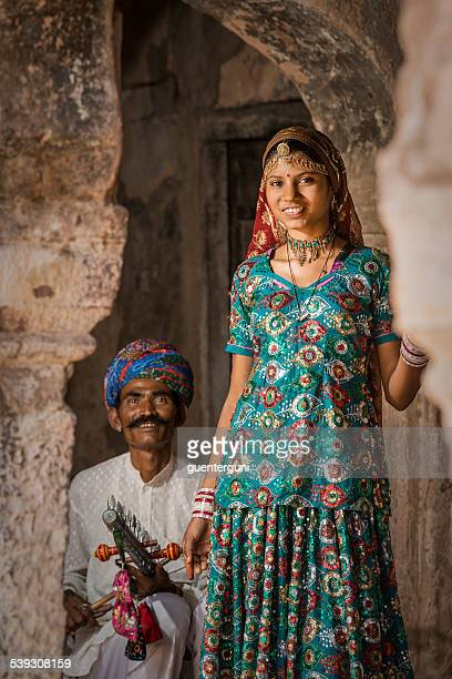 Father and daughter playing traditional music from Rajasthan, India