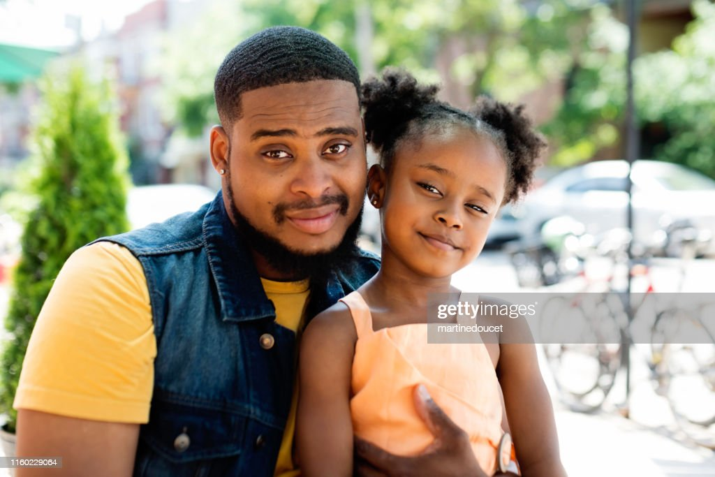 Father and daughter portrait on terrace outdoors. : Stock Photo
