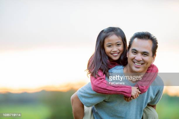 father and daughter portrait outside in the summertime - east asian ethnicity stock pictures, royalty-free photos & images