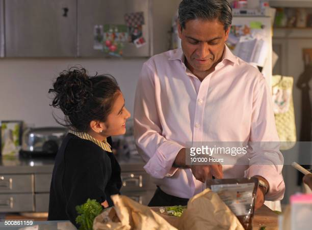 Father and daughter preparing an evening meal