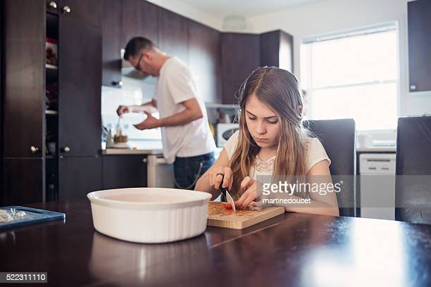 "father and daughter preparing food in home kitchen. - ""martine doucet"" or martinedoucet stockfoto's en -beelden"