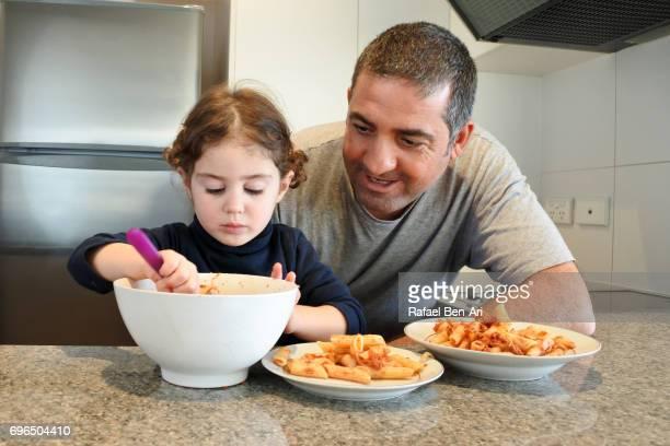 father and daughter preparing food together - rafael ben ari ストックフォトと画像