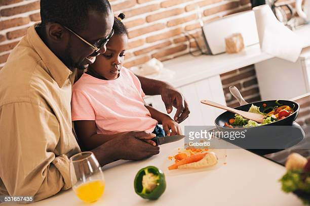 Father and daughter preparing lunch
