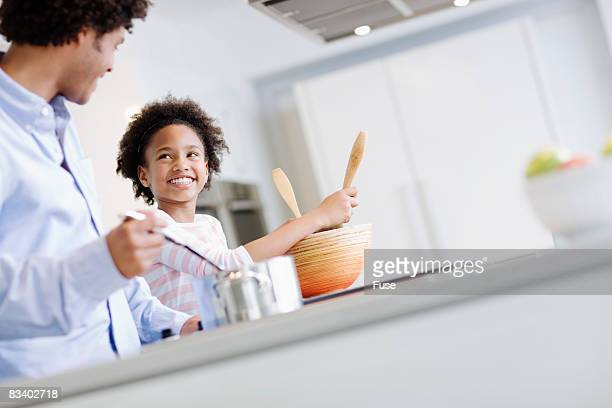Father and Daughter Preparing Meal