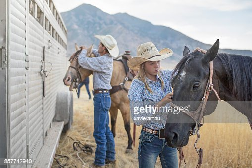 Father and daughter preparing the horses for an event in Utah, USA