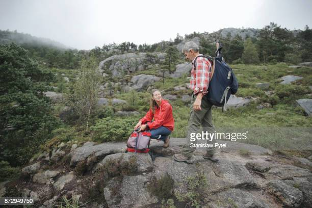 Father and daughter preparing their equipment for hiking