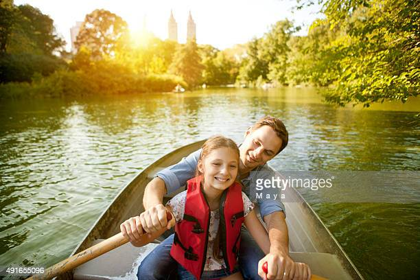 father and daughter rowing boat - central park stock pictures, royalty-free photos & images