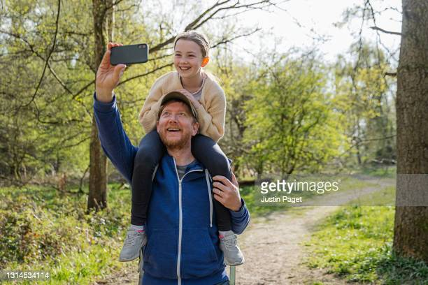 father and daughter selfie in the woods - outdoor pursuit stock pictures, royalty-free photos & images