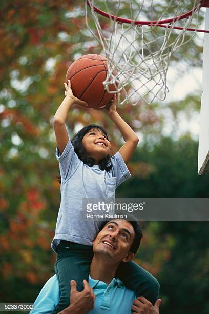 father and daughter shooting hoop - making a basket scoring stock pictures, royalty-free photos & images