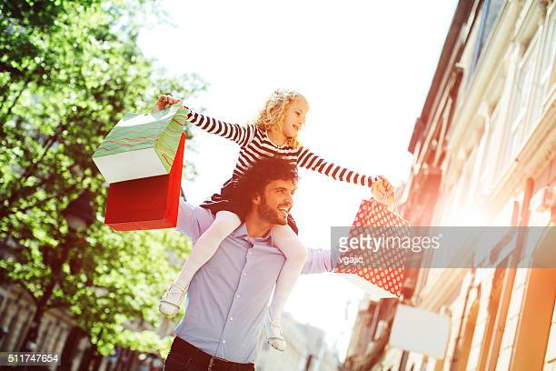 Father And Daughter Shopping Together.