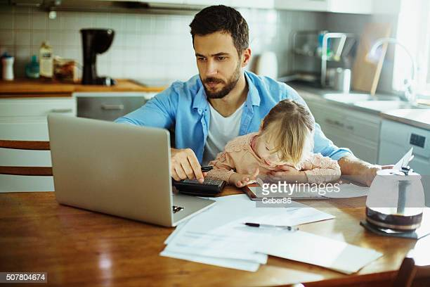 Father and daughter sitting in kitchen