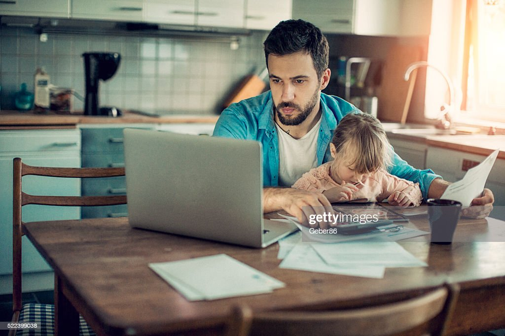 Father and daughter sitting in kitchen : Stock Photo