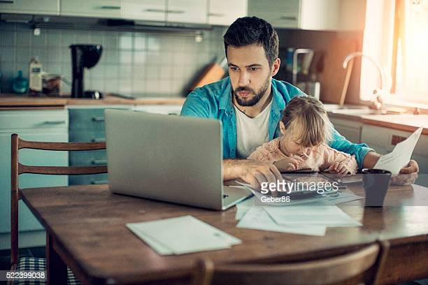 father and daughter sitting in kitchen - private stock pictures, royalty-free photos & images