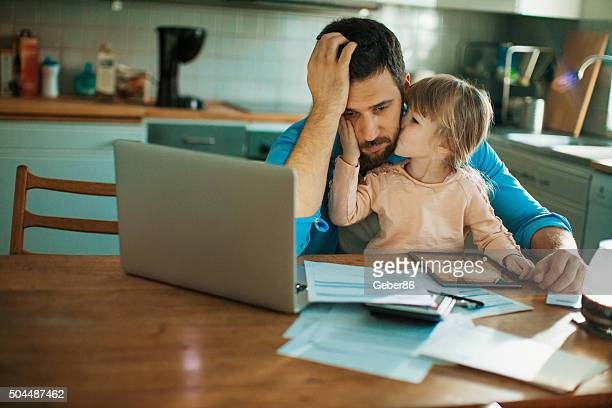 father and daughter sitting in the kitchen - burden stock pictures, royalty-free photos & images