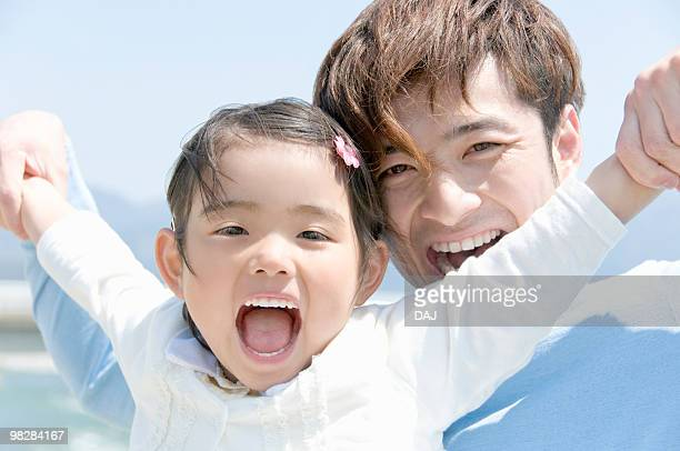 Father and Daughter Smiling