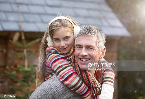 father and daughter smiling together. - kopfbedeckung stock-fotos und bilder