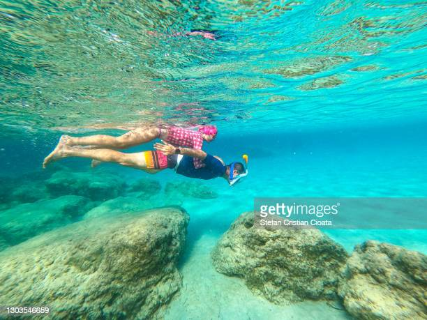 father and daughter snorkeling in zanzibar - underwater diving stock pictures, royalty-free photos & images