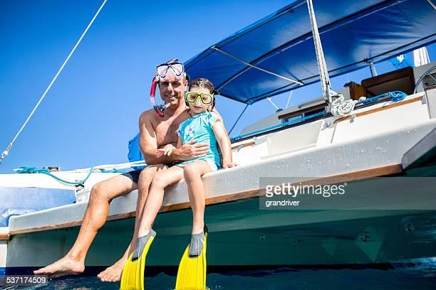 Padre e hija con esnórquel