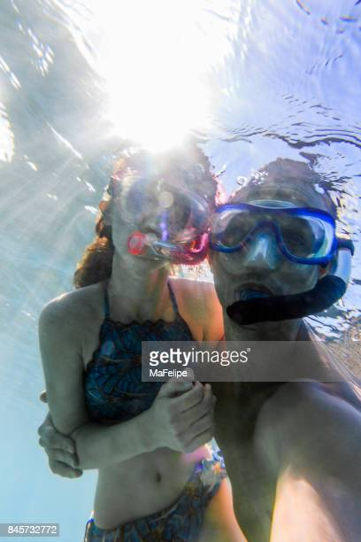 Father and daughter snorkeling together in Fernando de Noronha