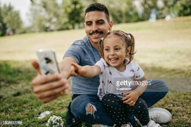 father and daughter spend quality time together - mid adult men stock pictures, royalty-free photos & images