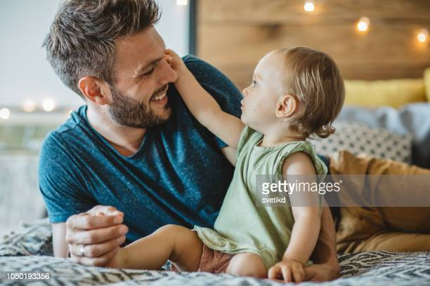 father and daughter spend weekend at home - stay at home father stock pictures, royalty-free photos & images