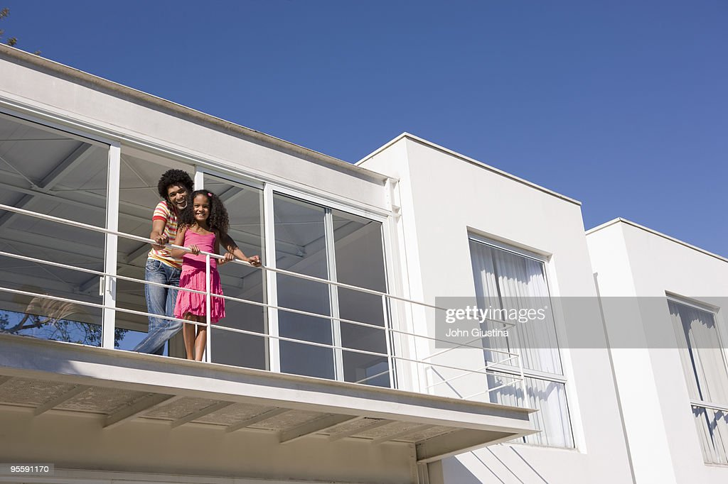 Father and daughter standing on deck. : Stock Photo