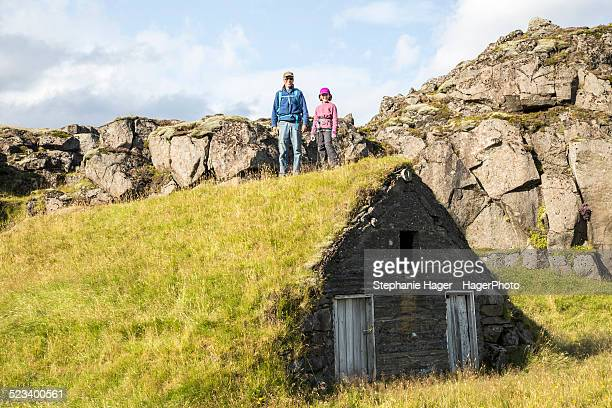 Father and daughter standing on top of sheep shelt