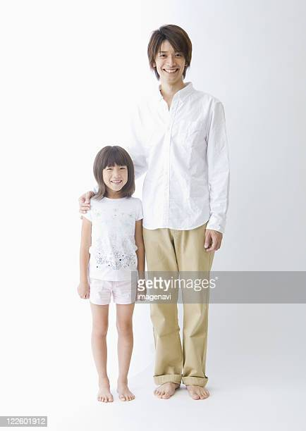 Father and daughter standing side by side