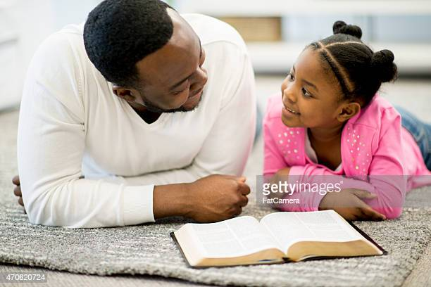 Father and Daughter Studying Bible