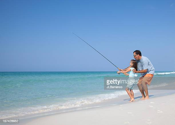 Father and Daughter Surf Fishing