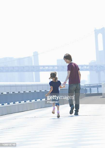 Father and daughter taking a walk