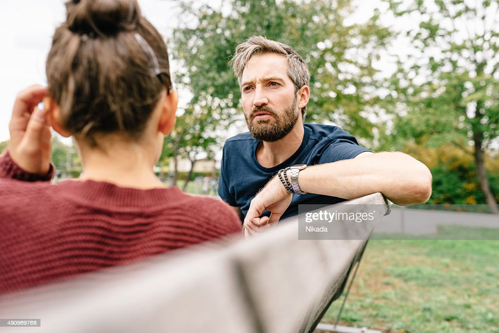Father and Daughter talking : Stock Photo