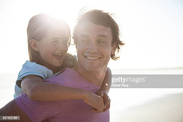 Father and daughter together on beach