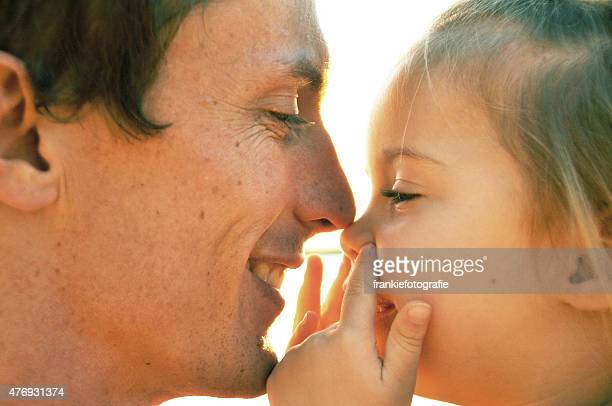 Father and Daughter touch noses