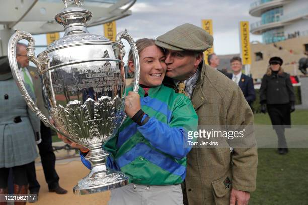 Father and daughter trainer and jockey Eugene Ou2019Sullivan and Maxine Ou2019Sullivan with the Foxhunters Trophy after victory with their horse It...