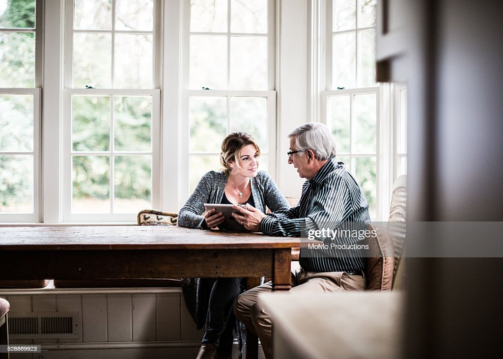 father and daughter using tablet : Stock Photo
