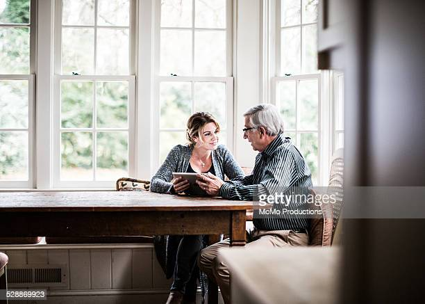 father and daughter using tablet - father daughter stock pictures, royalty-free photos & images