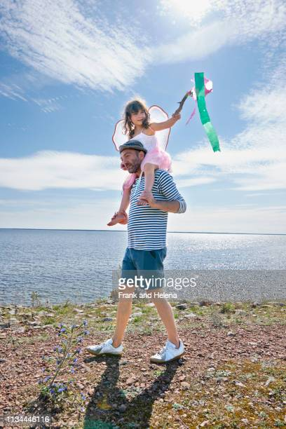 father and daughter walking by sea, eggegrund, sweden - fairy stock pictures, royalty-free photos & images