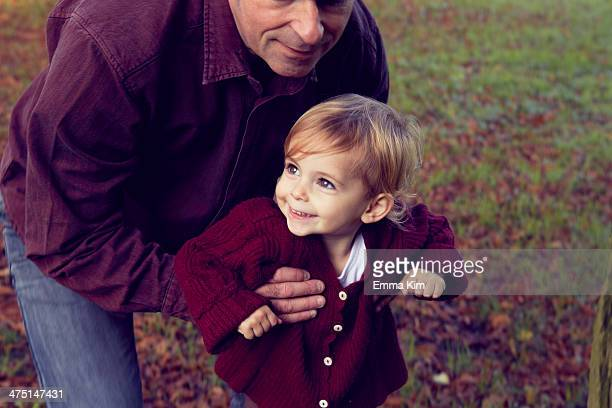 father and daughter walking through forest - maroon stock pictures, royalty-free photos & images