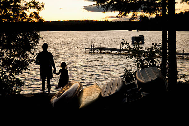 Father And Daughter Watch A Sunset On Beech Hill Pond Wall Art