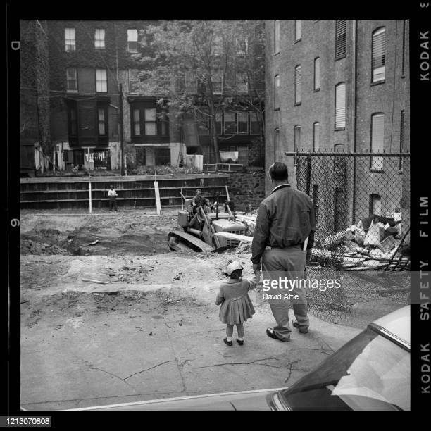 A father and daughter watch construction in Brooklyn Heights in March 1958 in New York City New York