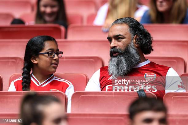 Father and daughter watch the match during the Pre-Season Friendly match between Arsenal and Chelsea Women at Emirates Stadium on August 1, 2021 in...